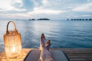 Man sitting on a lake dock