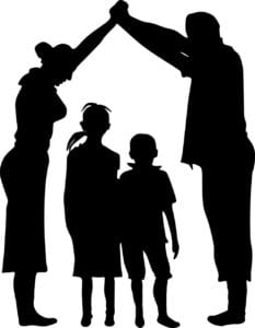 silhouette of a adults holding hands above the head of two children